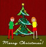 Ungar med julgranen Arkivbild