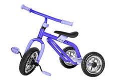 Ungar slösar trehjulingen Arkivbild