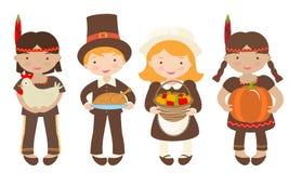 Ungar som delar mat för tacksägelse Arkivfoton