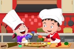 Ungar som gör pizza i köket royaltyfri illustrationer