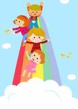 Ungar som glider på en regnbåge Royaltyfri Foto