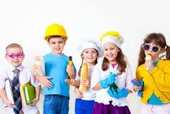 Ungar som leker i yrken Fotografering för Bildbyråer
