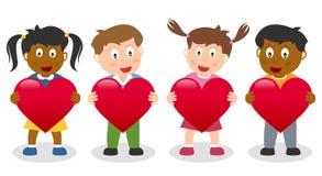 Ungar som rymmer en röd hjärta Fotografering för Bildbyråer