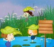 Ungar som spelar i regnet royaltyfri illustrationer