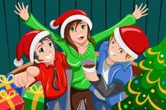 Ungdomarsom har ett julparti stock illustrationer