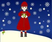 Unge i snön Arkivbild