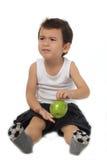 Unge och äpple Royaltyfri Fotografi