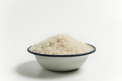 Ungekochter Reis in der Schüssel Lizenzfreie Stockfotografie