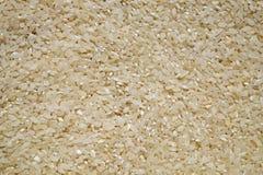Ungekochter weißer Reis Stockfotos