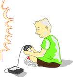 Ungen leker videogamen Arkivfoto