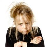Ungepflegtes Vorschülermädchen mit dummem Gesicht Lizenzfreie Stockfotografie