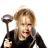 Ungepflegtes Vorschülermädchen mit Suppenschöpflöffel Lizenzfreie Stockfotografie