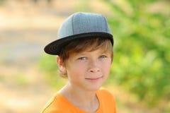 Ungepojke på naturbakgrund royaltyfria foton