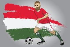 Ungernfotbollspelare med flaggan som en bakgrund Arkivfoton