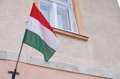 Ungersk flagga på väggen Fotografering för Bildbyråer