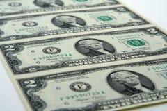 Ungeschnittene zwei Dollarscheine Stockbild