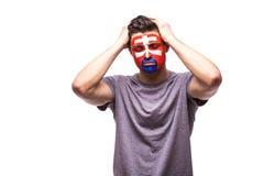 Unglücklich und Ausfall des Ziels oder verlieren Sie Spielgefühle des slowakischen Fußballfans Stockfotografie