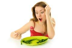 Unglückliche Frau, die eine Diät hält Stockfotografie