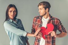 Unglückliche junge Paare Stockfotos
