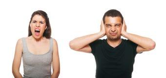 Unglückliche junge Paare, die ein Argument haben Stockfotos