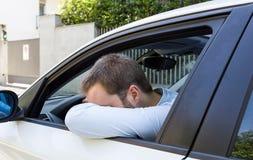 Unglücklicher Fahrer in seinem Auto Lizenzfreies Stockbild