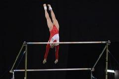 Ungleiche Stäbe 01 des Gymnast Stockbilder