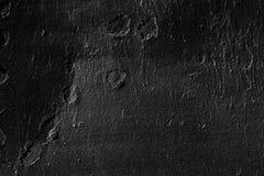 Ungleiche Wand gemalt mit schwarzer Farbe Stockfoto