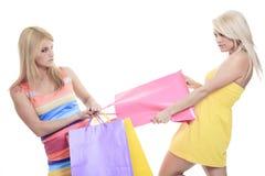 Ungry żeńscy kupujący ono uśmiecha się - odizolowywający nad a Zdjęcie Stock