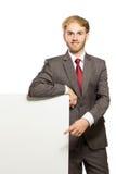Ungt affärsmananseende medan med en tom whiteboard, isola royaltyfri foto