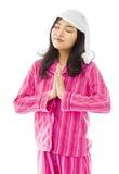Ungt asiatiskt kvinnaanseende i bönposition royaltyfria bilder