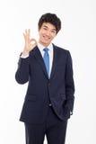 Ungt asiatiskt tecken för godkännande för visning för affärsman. Arkivfoton
