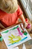 Ungt barnmålningbild Arkivbild
