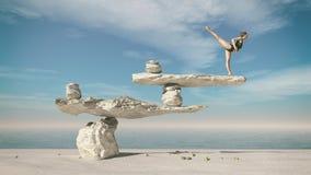 Ungt gymnastsammanträde på stenar Arkivfoton