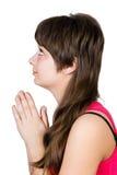 Ungt härligt be för flicka. isolerat Arkivfoton