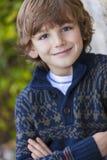 Ungt lyckligt le för pojke Arkivbild