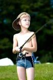 Ungt pojkefiske på en lake Royaltyfri Bild