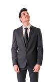 Ungt posera för affärsman som säkert isoleras på Royaltyfria Bilder