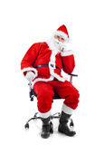 Ungt Santa Claus sammanträde på en kontorsstol. arkivfoton