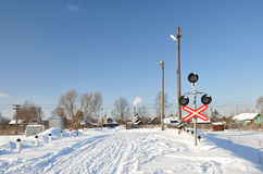 Unguarded railway crossing. Stock Photos