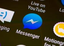 Unha do polegar/logotipo da aplicação do mensageiro de Facebook em um smartphone do androide Fotos de Stock Royalty Free