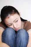 Unhappy. A girl showing unhappy facial expression Stock Photography