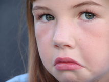 Unhappy. Little girl stock photography