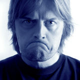 Unhappy. A mad / sad man with huge frown and angry eyes Stock Photos