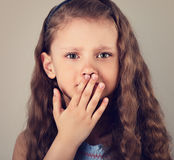 Unhappy afraid emotional small kid girl with teeth pain covering Royalty Free Stock Images