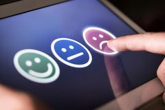 Free Unhappy And Disappointed Customer Giving Low Rating And Negative Feedback In Survey. Royalty Free Stock Photo - 131140535