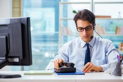 The unhappy angry call center worker frustrated with workload Royalty Free Stock Photography
