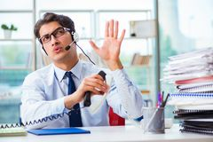 The unhappy angry call center worker frustrated with workload Royalty Free Stock Photo