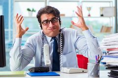 The unhappy angry call center worker frustrated with workload. Unhappy angry call center worker frustrated with workload Stock Image