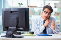 The unhappy angry call center worker frustrated with workload. Unhappy angry call center worker frustrated with workload Royalty Free Stock Photos