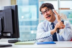 The unhappy angry call center worker frustrated with workload. Unhappy angry call center worker frustrated with workload Stock Photos
